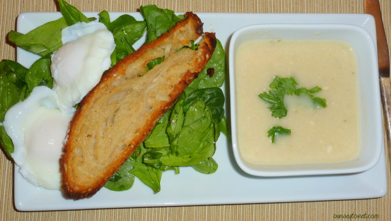 Tasty Supper of Cauliflower Soup and Toast with Poached Egg and Spinach Salad
