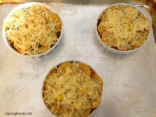 Nacho Pot Pies topped with cheese ourwaytoeat